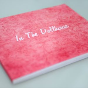 In the Dollhouse soft cover book a collection of essays, published pieces, interviews, candid photos, details and anecdotes about the project.